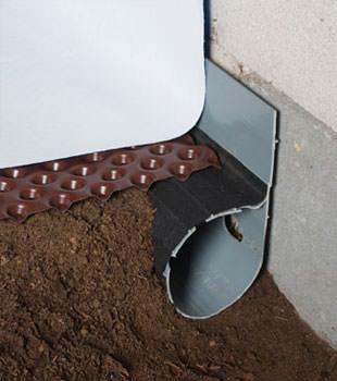 Closeup of a crawl space drainage system installed in Parlin